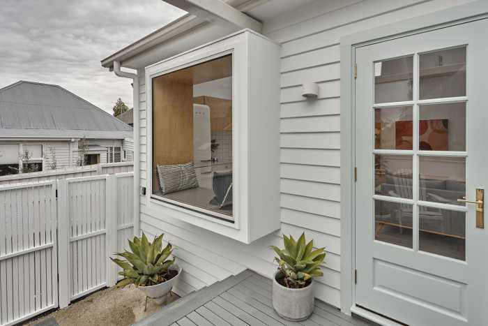Cement weatherboard with grey finishes