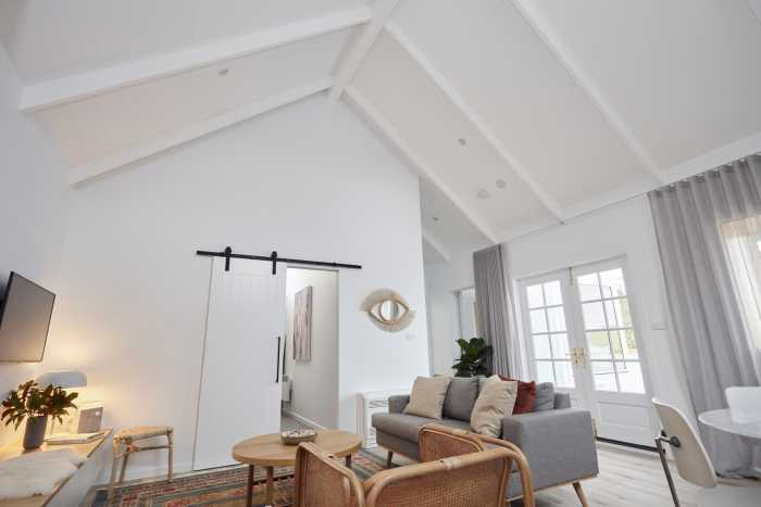 High ceilings with painted exposed beams