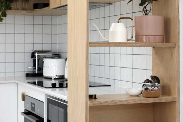Kitchenette with shelving units