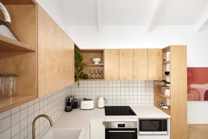 Timber finishes with white tiled splashback