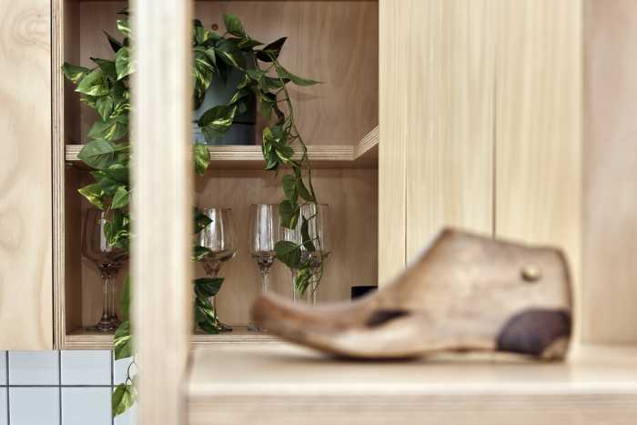 Wooden feature shelving units in kitchenette
