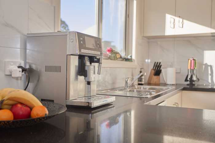 Kitchen with coffee machine