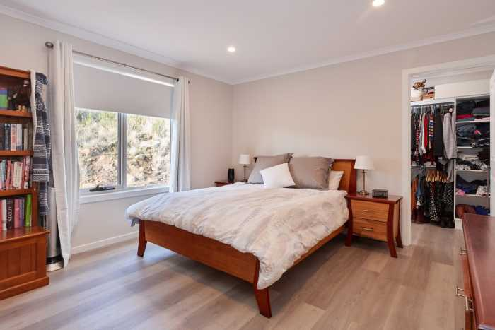 Timber vinyl flooring in bedroom with large walk in robe