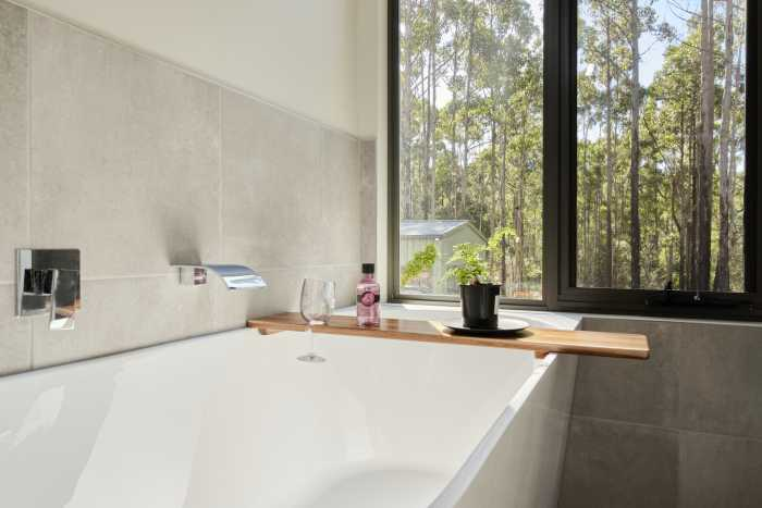 Bathroom with large grey Tiles