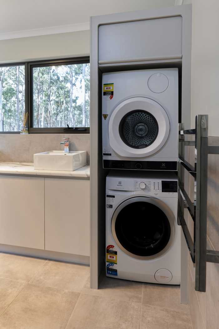 Double Stacked Dryer and Washing Machine in Laundry