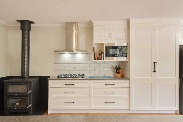 White Modern Kitchen with Wood fire place