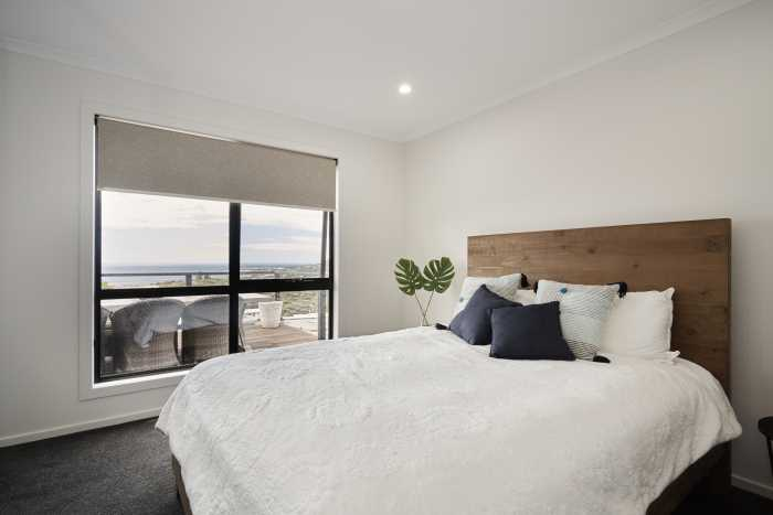 LED Downlights in bedroom with timber bed head