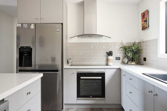 Large Open planned kitchen with tiled splashback