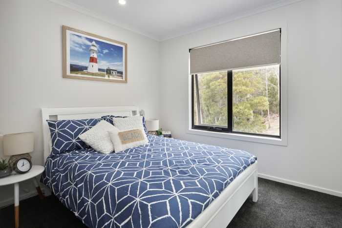 Large double bed room with blue quilt cover