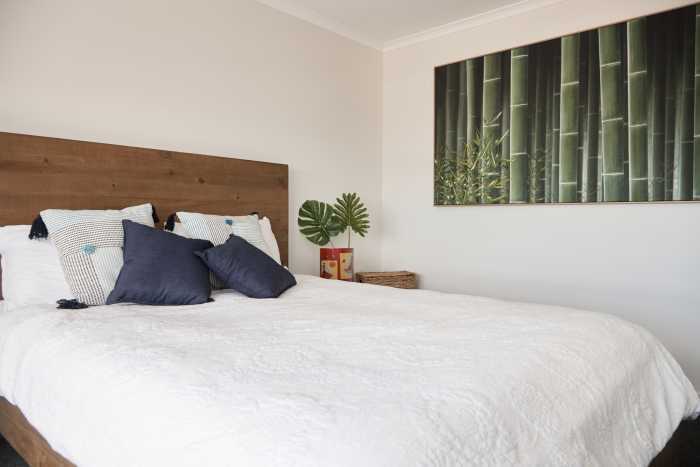 Timber bedframe with cream walls