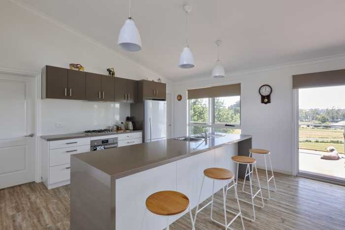 Brown and White Kitchen in Modular Home