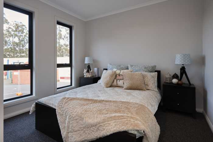 Tassie Build Expo Display Home Double bed bedroom pink cream and blue