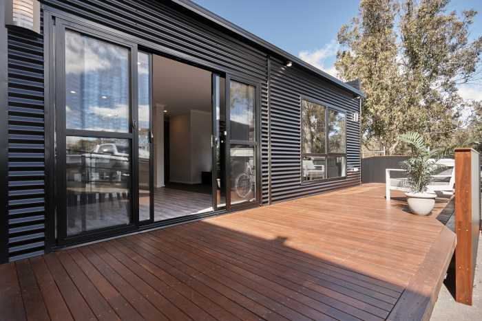 Tassie Build Expo Display Home Large timber jarrah deck stained