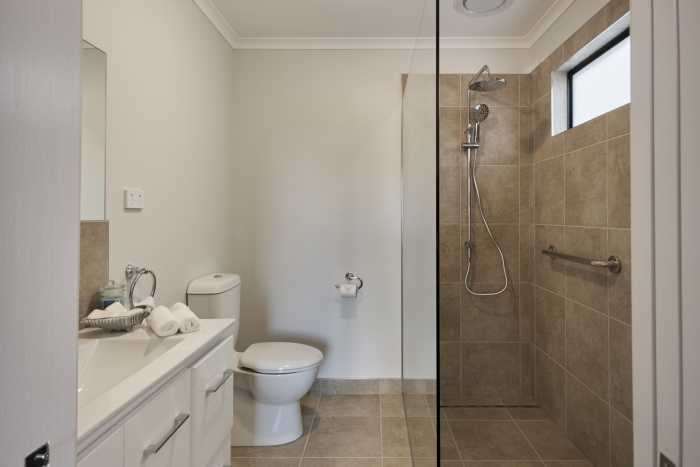 Tassie Build Expo Display Home ensuite beige tiles and white vanity