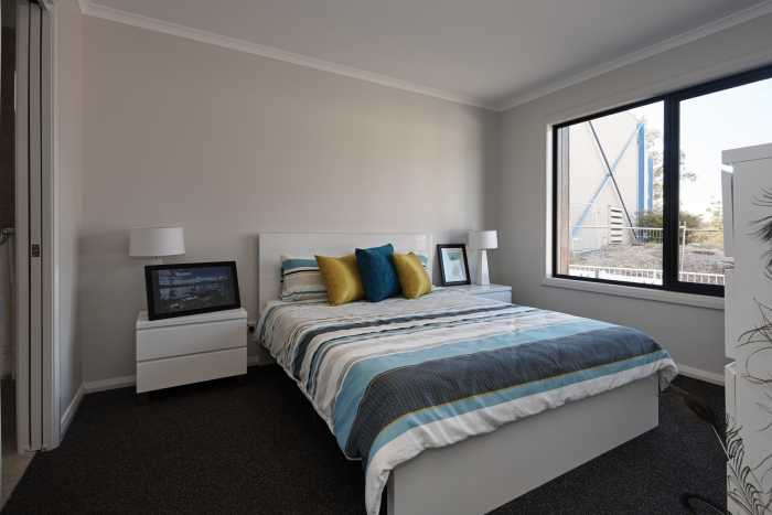 Tassie Build Expo Display Home master room with white modern bed