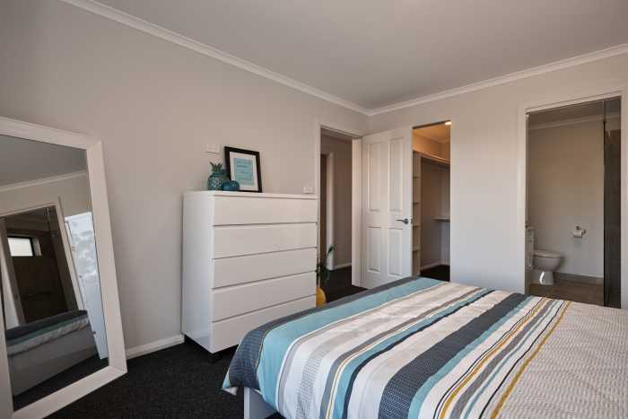 Tassie Build Expo Display Home with view of walk in robe and ensuite