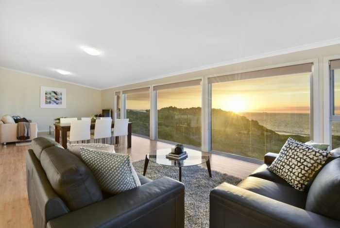 Living room with view of Tasmanian sunset
