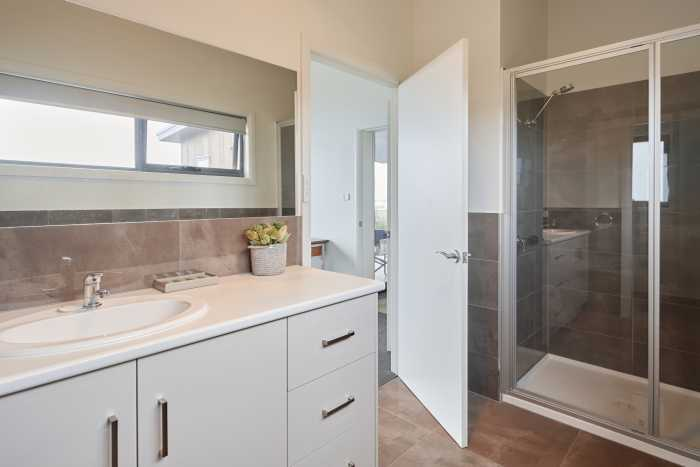 Ensuite with large shower and white vanity