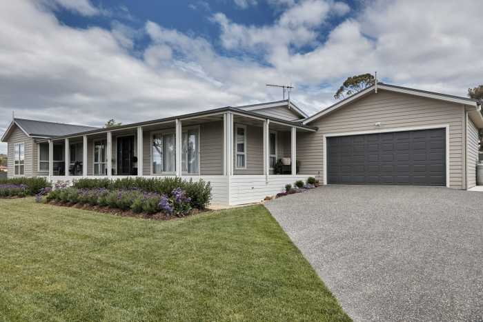 Cement Sheet Weatherboard with lanscaped garden