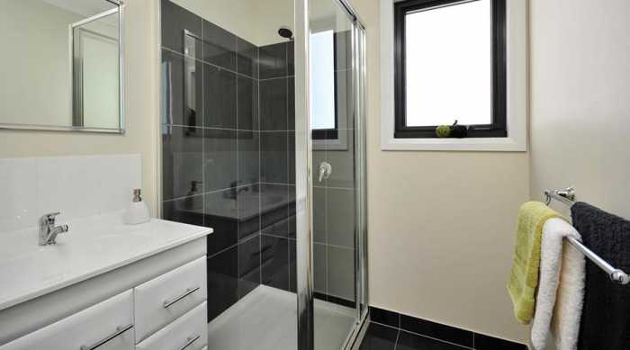 Black tiles in shower in Longford