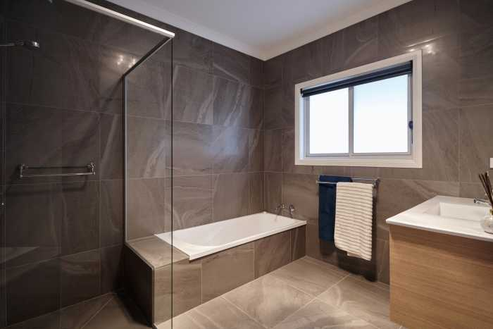 Modern Bathroom with brown tiles at Clarence P Oint