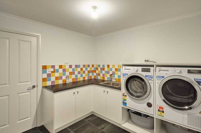 colored splashback in laundry in Beaumaris