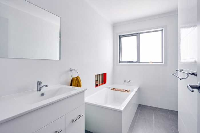 white bathroom tiles on East Coast Tas