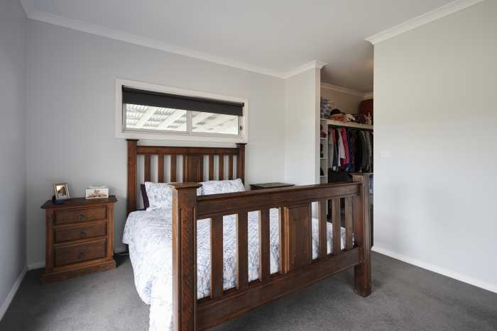 Bedroom with walk in robe at Clarence Point