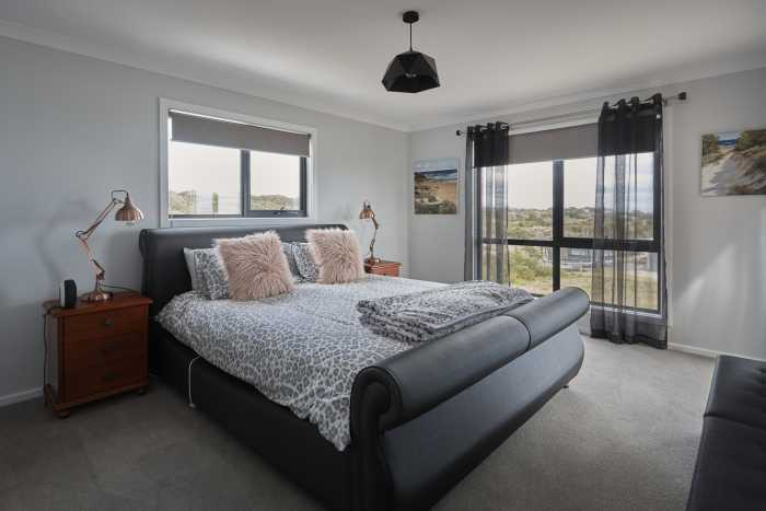 Large bedroom with views at Bellbuoy Beach