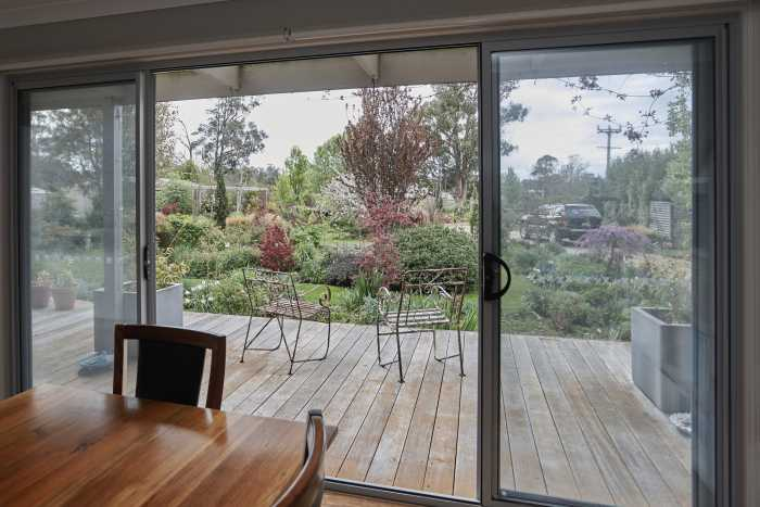 Dining room overlooking spring garden at Beaconsfield