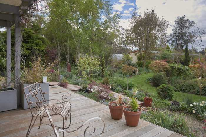 Dining room views of garden with wrought iron chairs at Beaconsfield