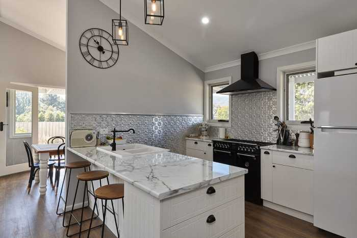 Country style kitchen with pressed tin splashback