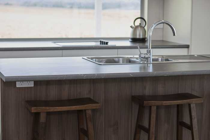 Island bench with laminex benchtop at Waterhouse