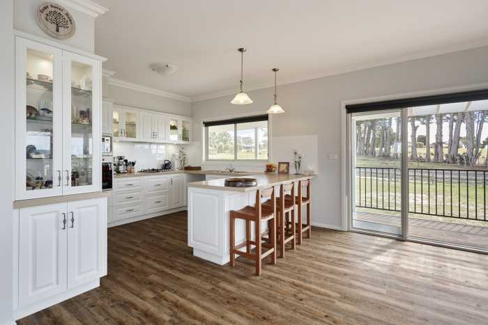Traditional Kitchen with floor boards at Clarence Point