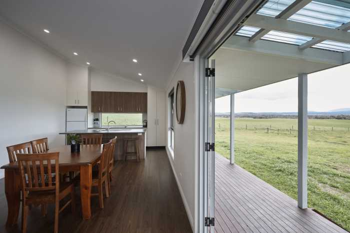 Large open sliding doors from dining room at Waterhouse