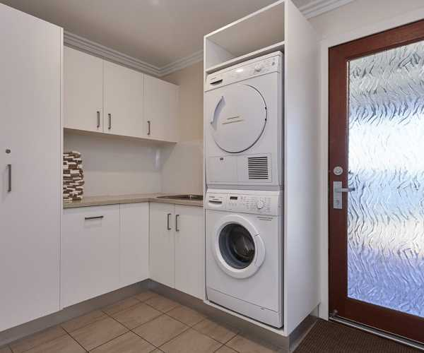 laundry fit out with glass door